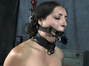 Cutie wears an metallic helmet during hardcore vulva banging
