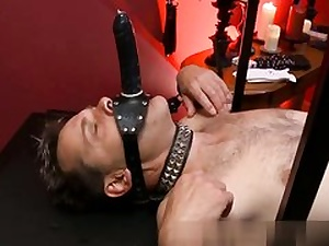 Kinky guys dressed in a giant strap-on getting a nice swift hand job