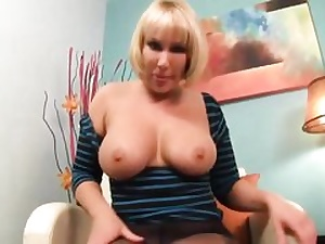 Mature blonde plump damsel is showing her boob and her labia crevice