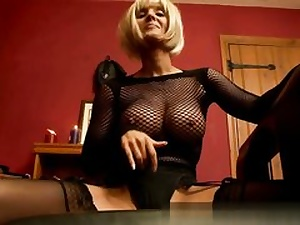 Sumptuous blonde dressed in fishnet and rubbing her moist poon crevice on camera