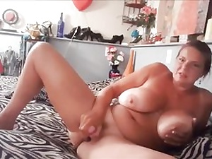 Insane mature bitch with giant boobs milking her twat fuckhole