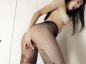 Teenage whore is dressed in a insane net taut and she is pleasing her sweet cunt