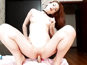 Hottie crimson haired stunner is fingering her both fuckholes with dildos