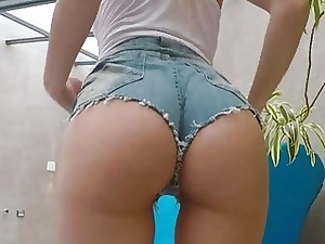 Mind-blowing nubile taunts with her epic culo in tight denim